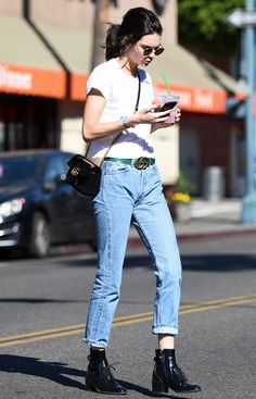 On Kendall Jenner: Ray-Ban 50mm Rounded Sunglasses ($150); Re/Done|Hanes The 1960s Slim Tee ($78); Gucci GG Marmont 2.0 Bag ($1890) and Gucci Ayers Belt with Double G Buckle ($750); Louis Vuitton Republic Ankle Boots.