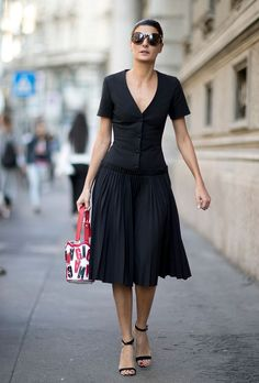 Browse the Best Street Style Outfits from Milan Fashion Week Spring 2017 at @StyleCaster | black V-neck dress with pleated skirt