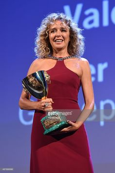 Actress Valeria Golino on stage with the Coppa Volpi for best Actress Award for the movie 'Per Amore Vostro' at the closing ceremony during the 72nd Venice Film Festival on September 12, 2015 in Venice, Italy.