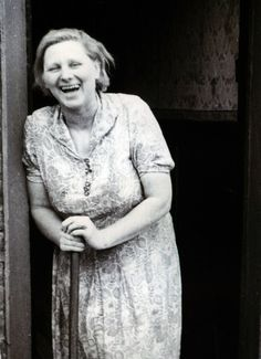 The Krays' Aunt May, laughing outside the Kray's home in Bethnal Green