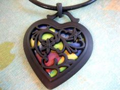 """https://flic.kr/p/8HoQxS   Polymer Clay Faux """"Stained Glass"""" Heart Pendant   Base of meta heart pendant is polymer clay which was done with Cindy Lietz's Blend and Switch Technique. Rich in yellow, copper, blue and green. This item is being donated to the Holiday Stocking Promotion on PCAGOE"""