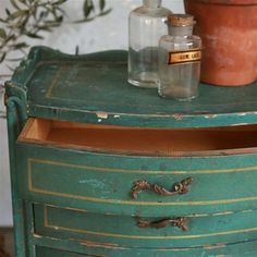 I created a very similar color by combining Annie Sloan Chalk Paint  Aubusson Blue and Antibes Green in the ratio of 3:1.  I followed up with clear wax and dark wax in areas with a touch of gilding wax on the front decorative molding.