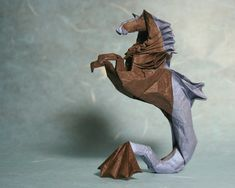 Hippocampus    Designed by Roman Diaz.  Folded by Phillip West.    Folded from an 11 inch piece of Origamido paper  from: http://designbeep.designbeep.netdna-cdn.com/wp-content/uploads/2010/02/26.origami-art.jpg
