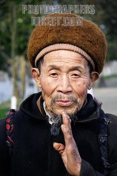 Portrait of posing old chinese man in traditional clothing . Huanglong Xi , Sichuan , China stock photo