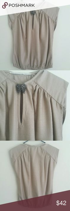 Twelfth Street by Cynthia Vincent Top Look elegant in this causal top by Cynthia Vincent. Beautiful gray/beige color. Bottom of top has an elastic hem. Condition: Excellent, like new!! 100% polyester.  NO TRADES!! Twelfth Street by Cynthia Vincent Tops