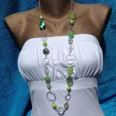 Long spring green and crystal statement necklace long by Aranji, $32.00