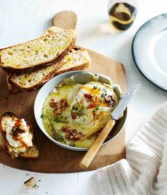 Honey-baked triple cream with walnuts and crostini
