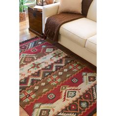 This transitional handwoven 8' x 11' area rug from Knoxville features a colorful southwestern pattern and fringed edges that will add visual interest to your home. Transform your living space by creating a whole new design theme around this rug.