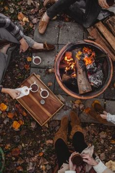 Fall inspiration and ideas. Hot chocolate by an outdoor bonfire surrounded by fall leaves and friends. Cozy sitting around a firepit in the backyard. Fall party and weekend ideas. Things to do during fall. Autumn Cozy, Fall Winter, Autumn Coffee, Autumn Tea, Autumn Feeling, Autumn Nature, Autumn Garden, Hello Autumn, Summer Fall