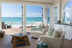 The spectacular shore view from this beach house is all the art that's necessary to complete the living room. It's gorgeous! Overstuffed upholstered chairs reflect a casual feel, and hardwood floors make for easy clean up. The coffee table with the rotating top is a unique and functional piece of furniture -- and conversation piece.