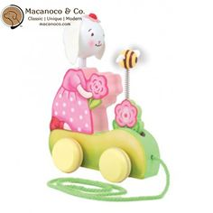 Bunnies By The Bay    Blossom's Blooming Wooden Pull Toy Blossom loves her Rosie Posies, give her flower cart a pull and watch them grow! Head turns, bee wobbles and flower goes up and down.    Natural wood toy has hand painted face and soft fabric features.      Size: 9 x 10 inches  Ages 18 months and up      Order athttp://www.macanoco.com/shop/bunnies-by-the-bay-blossoms-blooming-wooden-pull-toy/ | Shop this product here: spreesy.com/MacanocoAndCo/335 | Shop all of our products at…