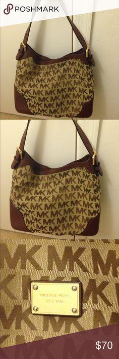 Michael Kors Handbag Nice designer bag. With magnetic clasp. Has a number of inside pockets. Michael Kors Bags Satchels