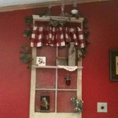 My new red wall and old decorated window!
