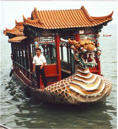 Dragon boats drove their passengers about the man-made Kunming Lake, China