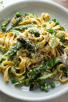 NYT Cooking: This simple pasta primavera uses a combination of the earliest vegetables available in spring — asparagus, peas and spring onions — making it a true celebration of the season. The sauce works best with springy egg pasta, preferably homemade or a good purchased brand. Make sure not to overcook it; you need the chewy bite to stand up to the gently cooked vegetables. If you can't find good fresh E...