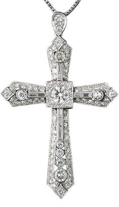 Art Deco Platinum Diamond Cross.  This big, bold and brilliant 1930s vintage platinum and diamond cross is bursting with 4.50 carats of bright white transitional European-cut, baguette and single-cut diamonds.
