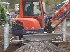 Mini excavator - it's between the sonotubes - there's something for everyone on this project. Mini Excavator, Simple Living, No Frills, Outdoor Power Equipment, Pearls, Website, Projects, Free, Ideas