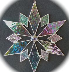 stained glass snowflake suncatcher (design 6B). $20.00, via Etsy.