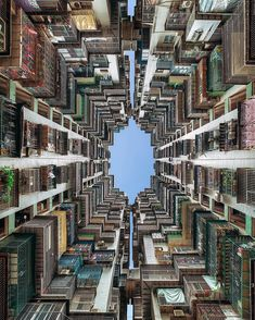 'Birdcage'  Looking up in-between the caged exterior of a high rise apartment block in Macau China #WowMacao