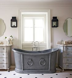A deep vintage zinc tub beckons in the master bath - Traditional Home®