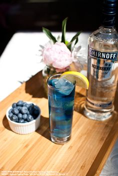 Blue Violet drink recipe with 1 oz SMIRNOFF® Blueberry Flavored Vodka, 0.25 oz blue-orange liqueur, 0.25 oz raspberry liqueur, 0.5 oz Sour Mix and 3 oz cranberry juice. Build in a tall glass over ice, top with cranberry juice and stir. Garnish with a lemon wedge. #LaborDay #Drink #Recipe #Smirnoff