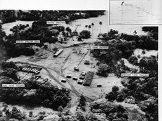 Evidence presented by the U.S. Department of Defense, of Soviet missiles in Cuba. This low level photo, made October 23, 1962, of the medium range ballistic missile site under construction at Cuba's San Cristobal area. A line of oxidizer trailers is at center. Added since October 14, the site was earlier photographed, are fuel trailers, a missile shelter tent, and equipment. The missile erector now lies under canvas cover. Evident also is extensive vehicle trackage and the construction of…