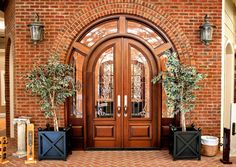 """Door Style DbyD-1004-A  This Custom Mahogany Radius Entryway features a pair of  30"""" X 96""""  Double Radius Top doors and 14"""" Custom Wrap Around Sidelites.  The picture below shows the inside with 8711 Casing with 8387 Backband with a Keystone at the top and fluted legs with a plinth and header trim."""