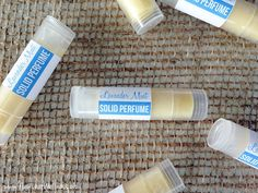 How to make your own solid perfume sticks with beeswax, coconut oil, and essential oils.  Love!