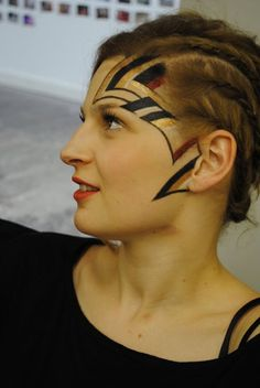 Side face tribal makeup and plaits