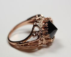 belonging to the darkness. rose gold vermeil & black cz. $170.00, via Etsy.