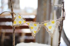 A charming rustic couples shower with a burlap bunting on the cake!