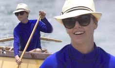 Looking oar-some: Charlize Theron shows off her beach body as she enjoys day of kayaking on holiday