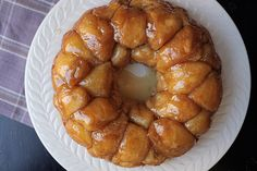 This decadent pull-apart loaf is composed of bite-sized yeasted rolls that get covered with a sticky-sweet brown sugar glaze and then baked together in a bundt pan.