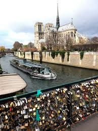 Paris -- bridge where people put locks on the side of the bridge to insure their love for each other