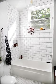 Metro Tile Design perfect mix of white hexagon floor tiles and white metro tiles in
