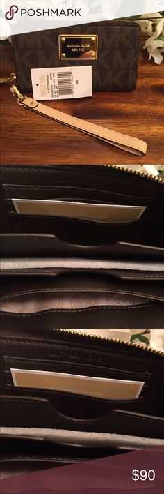 "Brown MK wristlets MICHAEL Michael Kors Zip Around Signature Multifunction Case Wristlet ~ 3 Credit Card Slots ~ 3 Large Open Slots ~ Center Slot Fits Iphone ` Zip Around 3 Sides Closure ~ Gold Tone Hardware ~ Goldtone Michael Kors Front Plaque ~ Wristlet Strap is Removable ~ Measures Approximately 6.5"" (W) X 3.75"" (H) X1"" (D) ~ Wristlet Strap 8"" Drop Michael Kors Bags Clutches & Wristlets"