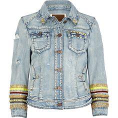Bracelets over denim jacket