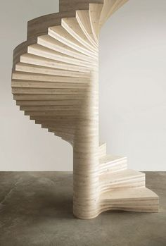 Spiral staircase built from cross-laminated timbers, which were computer milled into precise profiles and then stacked. Design by Tron Meyer. Photo by Rumi Baumann.