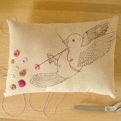 The Button Collector no. 98 Button Bird Pillow by eggagogo on Etsy - pinning this for inspiration... I have some small bird embroidery patterns that I could use to embroider little pincushions.