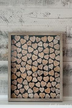 A wooden heart guest book that doubles as wall art for your home.