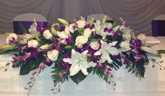 White orientals roses and orchid Bridal table flowers