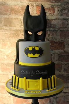 Batman birthday cake with mask, cape and belt. Perfect for any age! By Cakes by Camille.