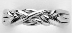 Ladies 4 Band Sterling Silver Puzzle Ring. $24.00, via Etsy. (DAVID?)