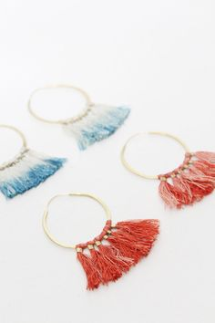 """Hand hammered brass, 14 carat gold-fill ear wire. Indigo dip-dyed silk for blues & Alkanet/Sandalwood dip-dyed silk for reds. Subtle shifts in color are part of the natural dye process. Measures 2 ¼ """""""