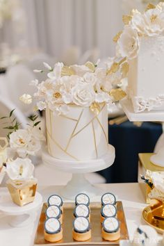Glamorous Gold and White Toronto Wedding at Graydon Hall Manor - MODwedding - Featured Photographer: Mango Studios; Gold And White Cake, Gold Cake, Geometric Cake, Geometric Wedding, Cake Truffles, Cupcakes, Gold Accent Decor, Romantic Candles, Gold Bridal Showers