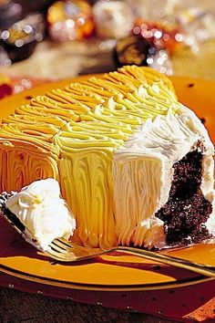 Create a cake version of the popular Halloween candy by frosting wedges of rich chocolate cake with orange, yellow and white buttercream frosting to resemble pieces of candy corn. It's a great recipe to make for a Halloween carnival cake walk.#halloween #halloweenrecipes #myrecipes