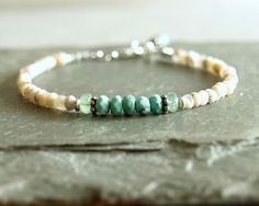 Sleeping Beauty turquoise bracelet, genuine Columbian emeralds, sterling, dendritic opals, natural gemstones, multi-bead turquoise jewelry https://www.etsy.com/listing/227881007/sleeping-beauty-turquoise-bracelet