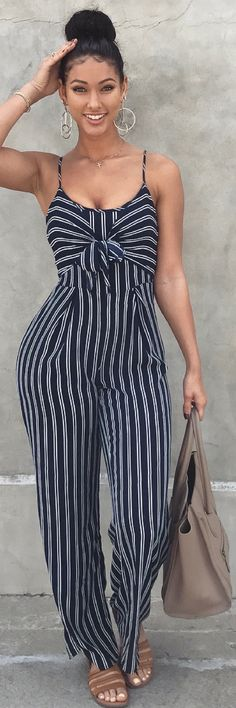 i love this look. from the bun and big hoops to the jumpsuit and tote.