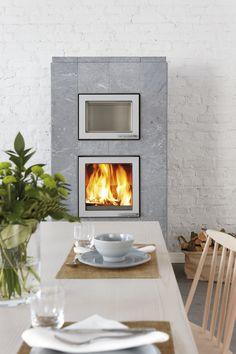 NORVA: The Norva's bakeoven is heated by the fireplace itself rather than needing any separate firewood supply. The bakeoven can be placed above the firebox door or on the opposite side of the fireplace.
