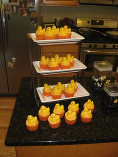 Duck cupcakes, with a chocolate mold duck on top Duck Cupcakes, Chocolate Molds, Baby Shower, Desserts, Top, Baby Sprinkle Shower, Tailgate Desserts, Spinning Top, Baby Sprinkle